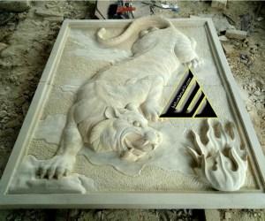 Batu ukir relief harimau
