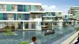 Häuser auf einem See mit Kanufahrer
