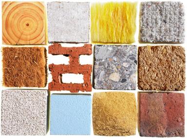 Sammlung verschiedener Baustoffe Holz Beton Dämmstoff Ziegel