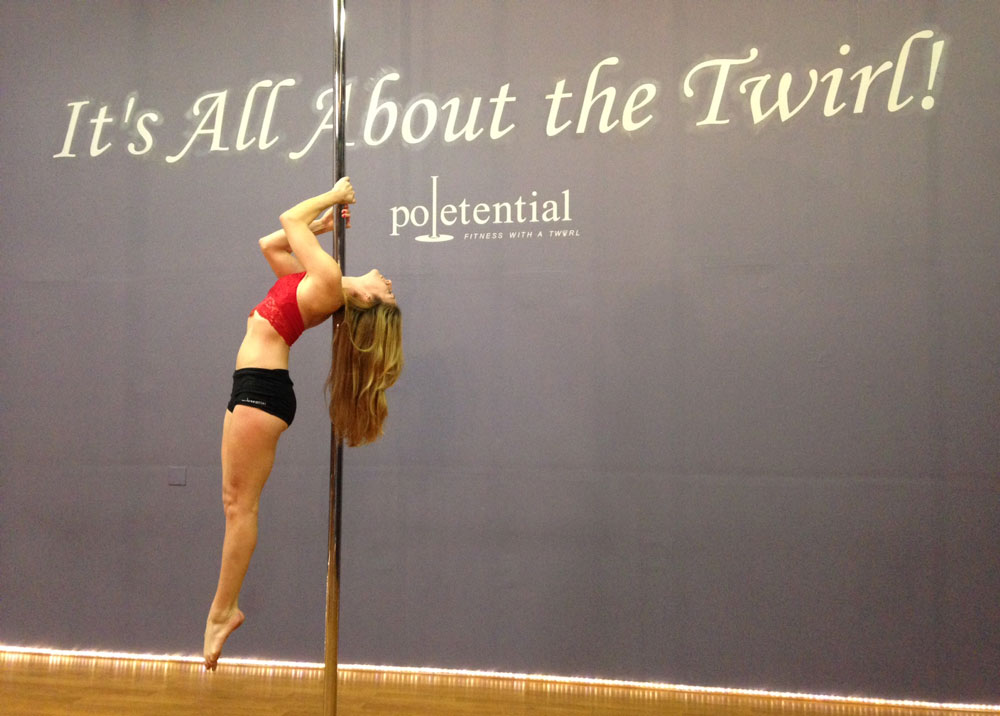 A woman in a pole-dancing class