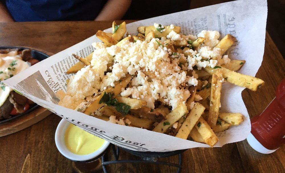 Fries on the Happy Hour menu at Opa!