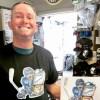 Man smiling, wearing Hertl t-shirt showing Hertl artwork print