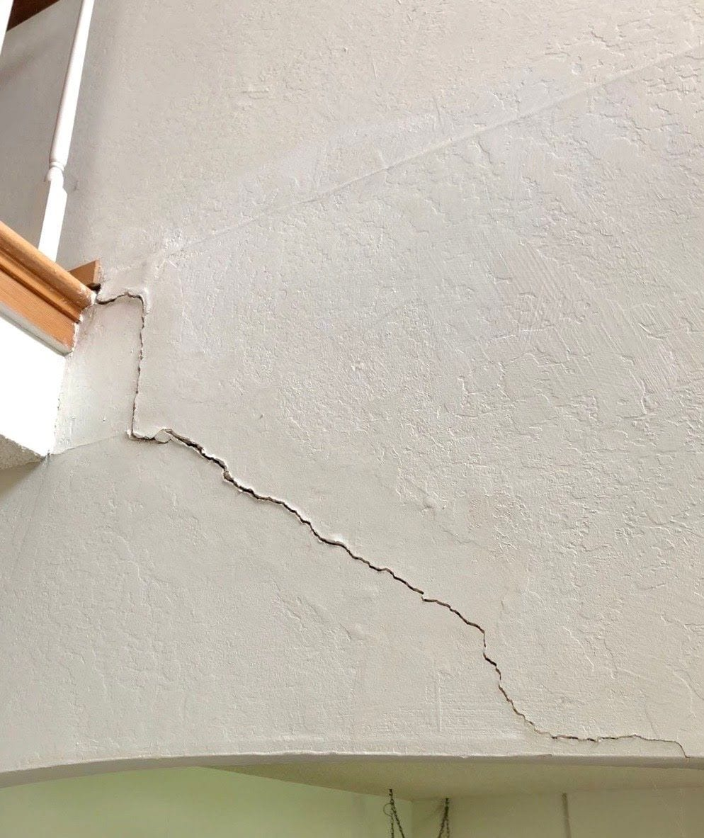 Interior signs of foundation problems - wall cracks
