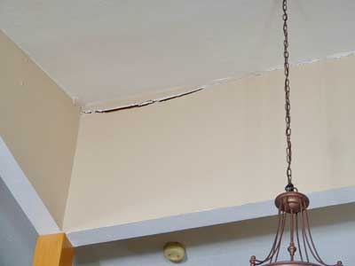 Ceiling crack caused by foundation damage