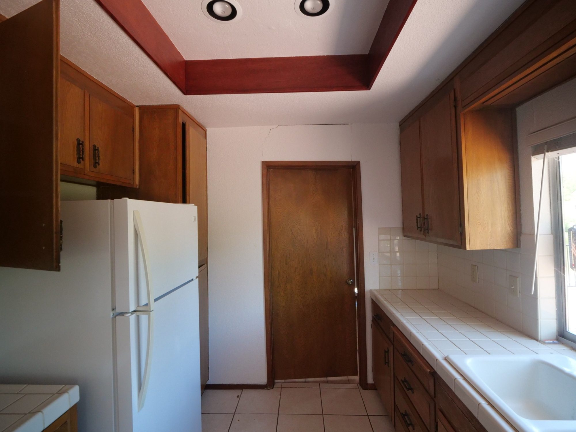 kitchen with a foundation crack above the door