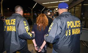 Couch, escorted by Marshalls to a waiting car in Los Angeles for return to Texas.