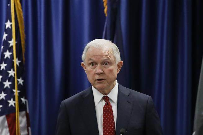 In bed with Trump, Jeff Sessions threatens to amp up fight against leaks