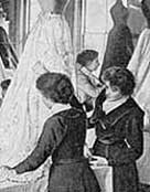 Two Victorian woman working on the stitch work of a womans dress