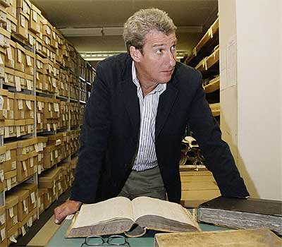 Jeremy Paxman with one of his larger books, we hope (BBC)