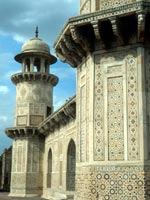 Intricately decorated walls and towers make up Itimad-ud-Daulah's tomb