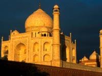 Corner of the Taj Mahal palace in golden sunlight