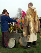 Druids in ritual costume watch as a couple joins hands across an altar