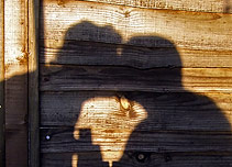 A shadow of two people kissing