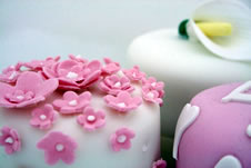 A selection of cakes decorated with icing.