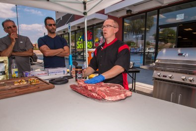 Chef Phillip Dell prepping meat — with Chef Phillip Dell at BBQ Concepts.
