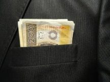 Money in suit top pocket