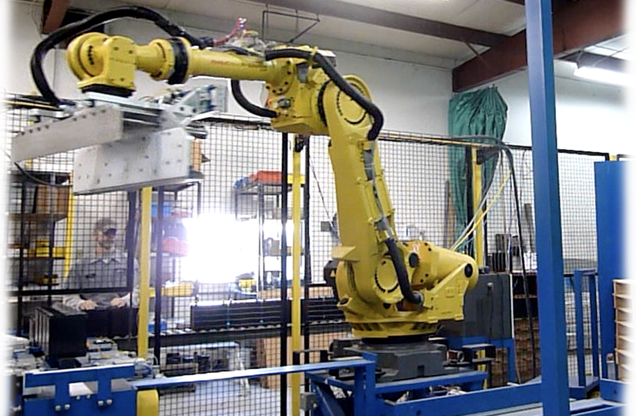 Image result for photos of robotic and automated systems in manufacturing companies