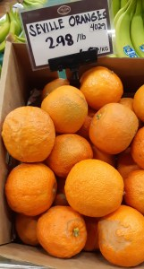 Seville oranges in bin are not all pretty
