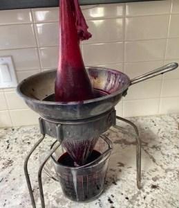 salal juice draining through colander