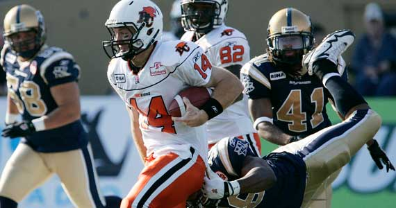 Travis Lulay evades Winnipeg tacklers.