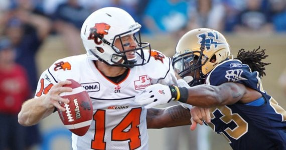 Travis Lulay and Jonathon Hefney - Photo Credit: John Woods - Canadian Press