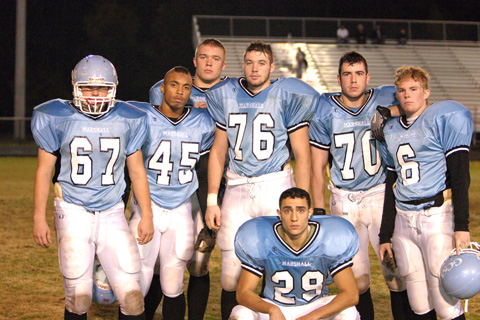 The Marshall seniors pose following their final game Friday night against Madison.  (Photo: Karen Newcomb/MarshallFootball.org)