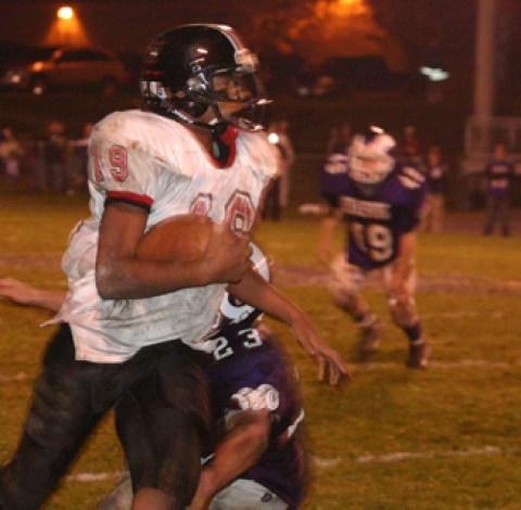 JOEL CHANDLER (10), BEN ZORN (50) and the rest of the Mustangs put the pressure on Madison County last Friday night. (News-Press photo)
