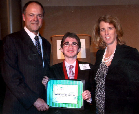 """CHRISTOPHER CASSIDY of Annandale was one of 12 students nationwide awarded as a """"national"""" scholar in the Toyota Community Scholars Program. Cassidy was selected from a pool of 8,000 students who were nominated by their schools. Rory Kennedy (at right), a documentary filmmaker, was the key note speaker at the award ceremony. Michael Rouse, a Toyota representative, poses with them. (Photo: courtesy Toyota Motor Sales)"""