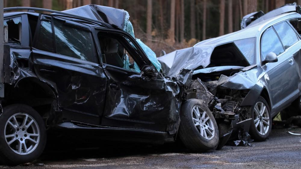A bad car accident shows two totaled vehicles