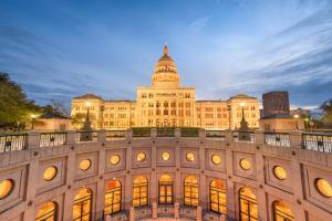 A sunset image of the Texas state capitol, where statewide laws regarding uber accidents were passed in 2017.