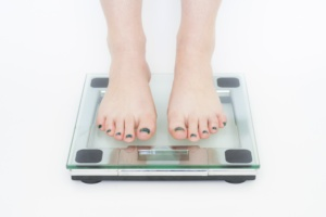 a person on a weighing scale