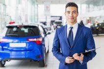 portrait-salesman-car-dealership_23-2148130116