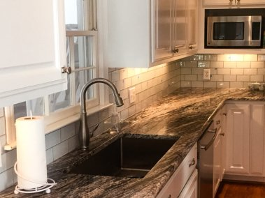 BDM-Residential-Remodeling-Atlanta-GA-Bright White Kitchen with Black & Gray Granite Accent