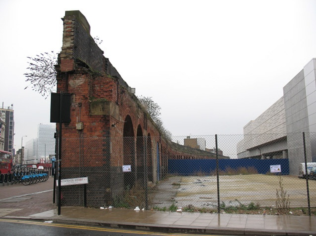 The outer brick wall of Bishopsgate goods yard, left standing alongside Bethnal Green Road