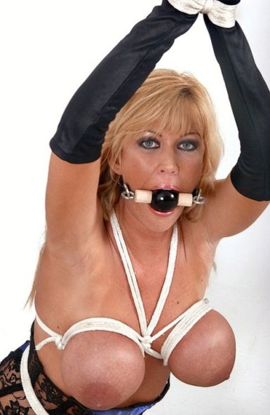 Gorgeous Blonde Tightly Bound and Gagged in Corset
