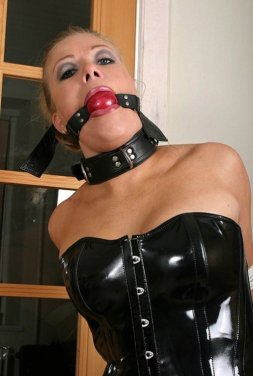Hot Blonde in Latex and Boots Tightly Bound at Home