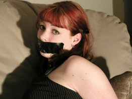 Pretty Young Redhead Tied Up and Gagged in High Heels by Her Boyfriend