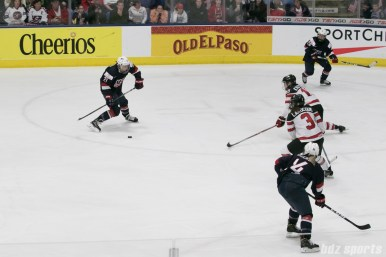 USA's Hilary Knight #21 prepares to take a shot that will become the OT game winner against Canada.