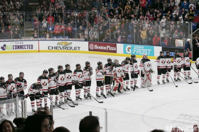 Team Canada looks on as team USA is awarded the 2017 IIHF Women's World Championships gold medal.