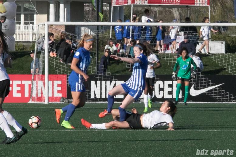 Sky Blue FC's Kelley O'Hara #19 tackles Breakers' Rose Lavelle #11.
