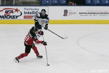 Canada's Halli Kryzaniak #18 takes a shot during the IIHF Ice Hockey Women's World Championship semifinal game