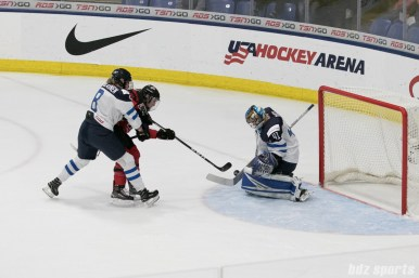 Finland's Noora Raty #41 denies another Canada scoring opportunity.