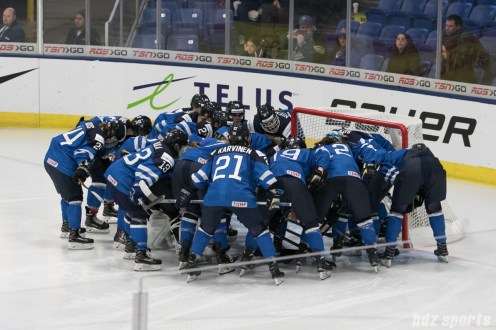 Team Finland huddling prior to the start of the 2017 IIHF Women's World Championships bronze medal game.
