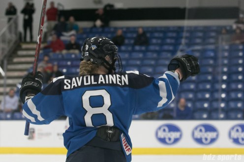 Finland's Ronja Savolainen #8 points to her teammates after scoring Finland's second goal of the game.