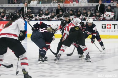 USA's Brianna Decker #14 prepares to face off against Canada's Marie-Philip Poulin #29.