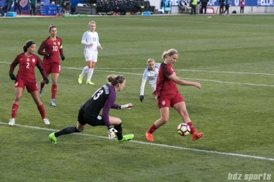 Team USA Lindsay Horan deflects on the ball