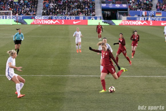Team USA Sam Mewis with the cross