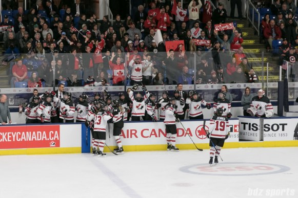 Team Canada reacts after official review confirms Brianna Jenner #19's goal.