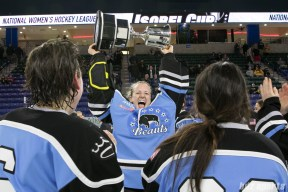 Beauts goalie and game MVP Brianne McLaughlin lifts the Isobel Cup