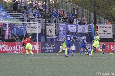 Breakers' Adriana Leon #19 dribble through the Reign FC defense to set up for a shot that would be the first goal of the game.